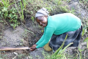 The Water Project: Mukhonje Community, Mausi Spring -  Grace Washes Her Hands At Mausi Spring