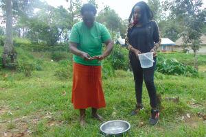 The Water Project: Bukhaywa Community, Ashikhanga Spring -  Handwashing Demonstrator