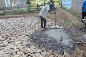 The Water Project: Friends Kuvasali Secondary School -  Pouring Concrete Foundation