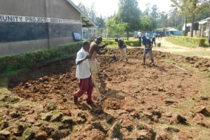 The Water Project: St. Peter's Khaunga Secondary School -  Community Members Help Excavate Rain Tank Site