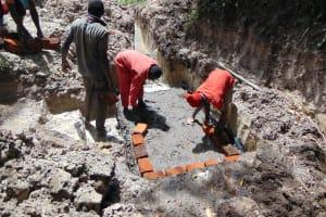 The Water Project: Bukhaywa Community, Ashikhanga Spring -  Brick Setting