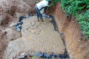 The Water Project: Chepnonochi Community, Shikati Spring -  Foundation Laying