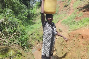 The Water Project: Mahira Community, Wora Spring -  A Woman Carrying Water
