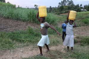 The Water Project: Mukhuyu Community, Chisombe Spring -  Young Girls Ferrying Water
