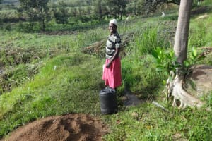 The Water Project: Mahira Community, Kusimba Spring -  A Community Member By The Spring