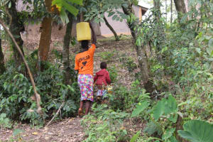 The Water Project: Litinye Community, Shivina Spring -  Joy And Mom Beatrice Carry Water Home