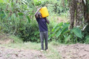 The Water Project: Litinye Community, Shivina Spring -  Mark Carrying Water