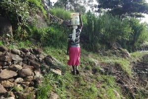 The Water Project: Mahira Community, Kusimba Spring -  Carrying Water From The Spring