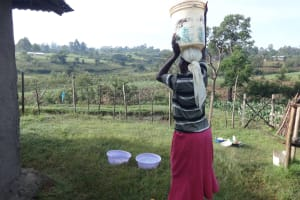 The Water Project: Mahira Community, Kusimba Spring -  Arriving Home With Water