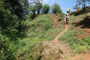The Water Project: Mahira Community, Wora Spring -  Carrying Water Uphill