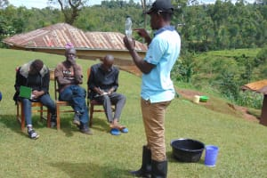 The Water Project: Chepnonochi Community, Shikati Spring -  Explaining Solar Disinfection