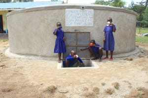 The Water Project: Makale Primary School -  Pupils Drinking Water From The Tank