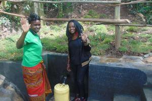 The Water Project: Bukhaywa Community, Ashikhanga Spring -  Georgina On Right With Community Member