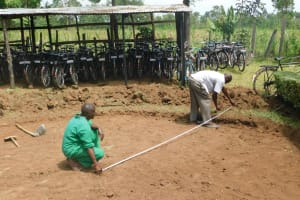 The Water Project: St. Peter's Khaunga Secondary School -  Measuring The Excavated Foundation