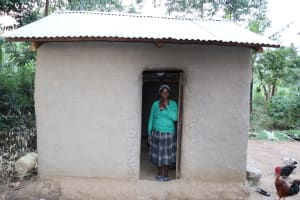 The Water Project: Mukhonje Community, Mausi Spring -  Grace Stands In Doorway Of Her Kitchen