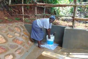 The Water Project: Chepnonochi Community, Shikati Spring -  Christine Gavalwa Fetches Water