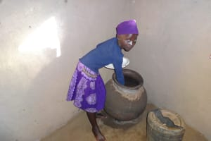 The Water Project: Mahira Community, Jairus Mwera Spring -  A Child Fetches Water From The Pot