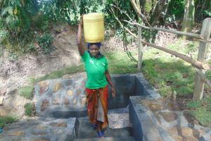 The Water Project: Bukhaywa Community, Ashikhanga Spring -  Bringing Clean Water Home