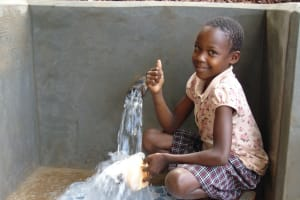 The Water Project: Chepnonochi Community, Shikati Spring -  Thumbs Up For Overflowing Fresh Drinks