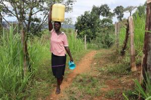 The Water Project: Harambee Community, Elijah Kwalanda Spring -  Nillah Carrying Water