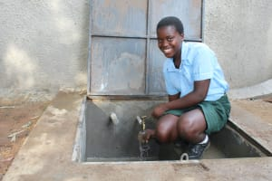 The Water Project: Friends Kuvasali Secondary School -  Rinsing A Cup With Clean Water