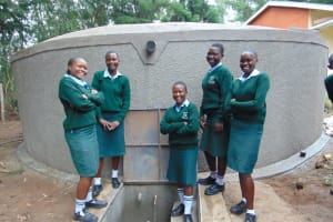 The Water Project: Friends Kuvasali Secondary School -  Girls Pose At The Water Tank