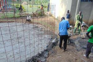 The Water Project: Friends Kuvasali Secondary School -  Setting Tank Wall Skeleton