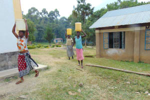 The Water Project: Friends Secondary School Shirugu -  Parents Carry Water To School For Construction