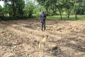 The Water Project: Litinye Community, Shivina Spring -  Mark Webo Inspects Land Before Planting Season