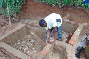 The Water Project: Chepnonochi Community, Shikati Spring -  Brick Work