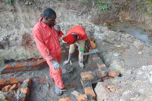 The Water Project: Bukhaywa Community, Ashikhanga Spring -  Pipe Setting