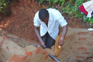 The Water Project: Chepnonochi Community, Shikati Spring -  Pipe Setting