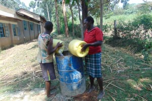 The Water Project: Friends Kuvasali Secondary School -  Community Members Deliver Water For Construction