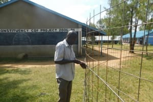The Water Project: St. Peter's Khaunga Secondary School -  Preparing Wire Tank Walls