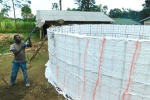 The Water Project: Makale Primary School -  Shoveling Cement Into Tank