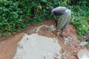 The Water Project: Chepnonochi Community, Shikati Spring -  Mixing Cement