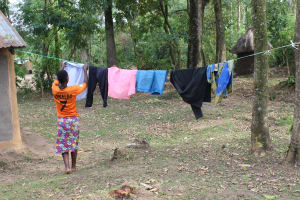 The Water Project: Litinye Community, Shivina Spring -  Beatrice Hangs Clothes To Dry