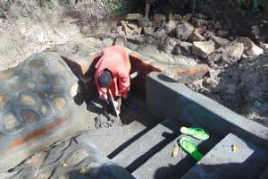The Water Project: Bukhaywa Community, Ashikhanga Spring -  Plastering