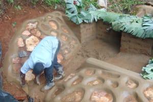 The Water Project: Chepnonochi Community, Shikati Spring -  Rub Wall Construction