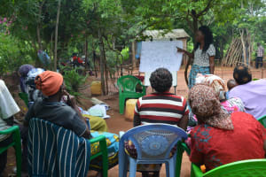 The Water Project: Katovya Community -  Community Members Listen During The Training