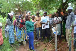 The Water Project: Katovya Community -  Facilitator Leads Handwashing Demonstration