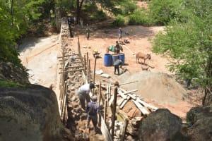 The Water Project: Katovya Community -  Building Up Dam Walls