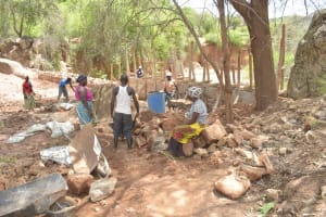 The Water Project: Katovya Community -  Community Members Working On The Dam