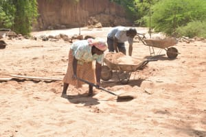 The Water Project: Katovya Community -  Digging Sand To Mix With Cement