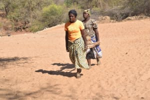 The Water Project: Katovya Community -  Hauling A Rock