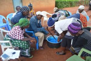 The Water Project: Kasekini Community A -  Mixing Soap