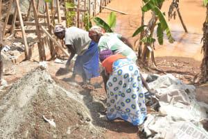 The Water Project: Kasekini Community -  Community Women Help Mix Cement