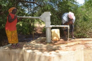 The Water Project: Katovya Community A -  Drinking Water From The Well
