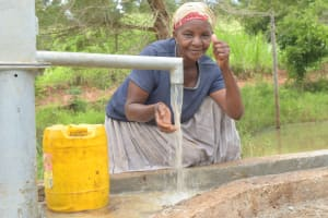 The Water Project: Kasekini Community A -  Thumbs Up For Reliable Water