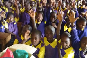 The Water Project: Murwana Primary School -  Students Raise Their Hands To Participate
